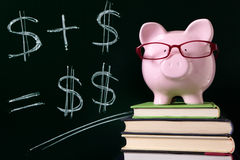 Piggy Bank with simple savings growth plan formula written on blackboard Stock Photos