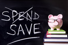Piggy Bank with blackboard Royalty Free Stock Images