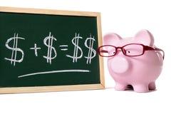 Piggybank with blackboard savings plan calculation Royalty Free Stock Images
