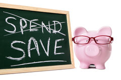 Saving plan, Piggy Bank with blackboard and spend save message Stock Image