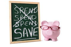Saving plan, Piggy Bank with blackboard spend and save message isolated on white background Stock Photo