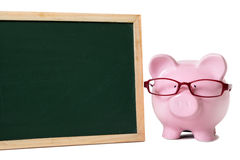 Piggy bank blackboard glasses isolated copy space Stock Photos