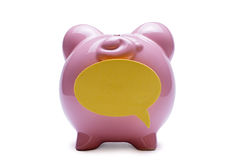 Piggy bank with a blank speech bubble Stock Images
