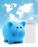 Piggy bank with block note on blue sky planet map background Royalty Free Stock Image