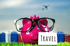 Piggy bank with blue sky and airplanes Royalty Free Stock Photos