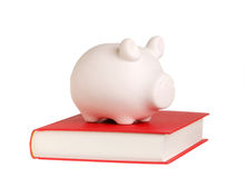 Piggy bank on a book Royalty Free Stock Photography