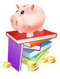Piggy bank on books. A piggy bank standing on a stack of books and surrounded by coins. Concept for eduction savings or other literacy related budget theme Royalty Free Stock Images
