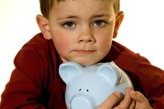 Piggy bank boy. Boy holding on to a piggy bank Royalty Free Stock Images