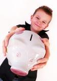 Piggy bank boy. Little boy is holding his piggy bank Stock Images