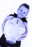 Piggy bank boy. Little boy is holding his piggy bank Stock Photography