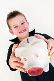 Piggy bank boy. Little boy is holding his piggy bank Royalty Free Stock Photo