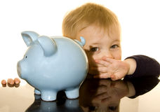 Piggy bank boy hiding Royalty Free Stock Photo