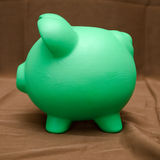 Piggy Bank on Brown Royalty Free Stock Photos