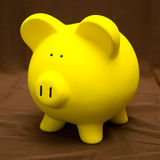 Piggy Bank on Brown Stock Photos