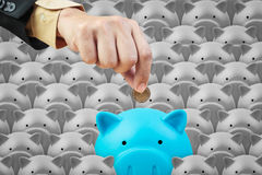 Piggy bank and business hand, saving finance concept Royalty Free Stock Photo