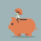 Piggy bank. Businessman sit and protect piggy bank Stock Photos