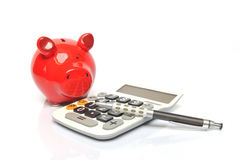 Piggy Bank Calculating Royalty Free Stock Photography