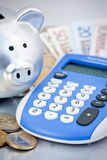 Piggy bank and calculator Royalty Free Stock Image