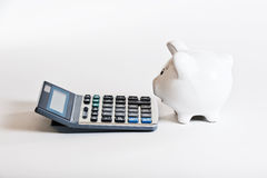 Piggy bank & calculator Royalty Free Stock Image