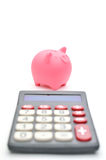 Piggy bank and calculator Stock Photos
