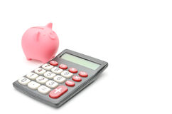 Piggy bank and calculator Royalty Free Stock Photography