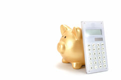 Piggy bank and a calculator Royalty Free Stock Image
