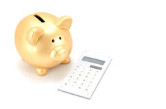 Piggy bank and a calculator Stock Photo
