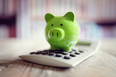 Piggy bank with calculator Stock Photos