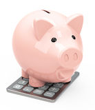 Piggy bank on a calculator. 3d generated picture of a piggy bank Stock Images