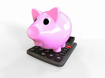 Piggy Bank on a Calculator Stock Photo