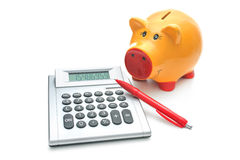 Piggy bank with calculator. Isolated on white Royalty Free Stock Image