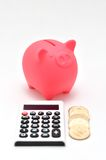 Piggy bank and Calculator and japanese coin. Royalty Free Stock Image