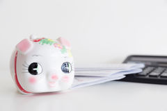 Piggy bank, calculator and statement Stock Images