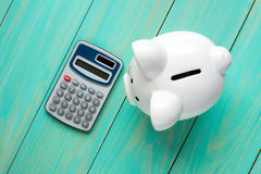Piggy bank and calculator,top view Royalty Free Stock Images