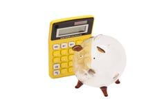Piggy bank and callculator Stock Image