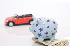 Piggy bank and car Royalty Free Stock Photos