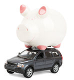 Piggy bank on car Royalty Free Stock Photography