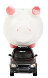 Piggy bank on car Stock Photos