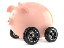 Piggy bank with car tires Stock Images