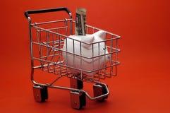 Piggy Bank Cart. A piggy cart stuffed with money in a shopping cart Royalty Free Stock Image