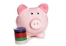 Piggy bank with casino chips Stock Photography