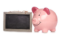 Piggy bank with chalkboard Stock Photo