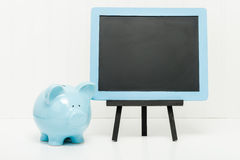 Piggy Bank and Chalkboard Stock Photo
