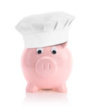 Piggy bank with a chef hat Royalty Free Stock Image