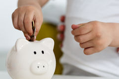 Piggy bank and child Royalty Free Stock Image