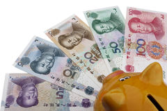 Piggy bank and Chinese money (RMB) Stock Photo