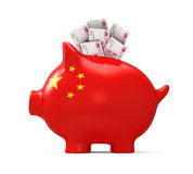 Piggy Bank with Chinese Yuan Royalty Free Stock Photo
