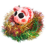 Piggy bank with christmas decoration Stock Images