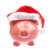 Piggy bank with christmas hat Royalty Free Stock Photos