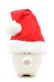 Piggy bank with christmas hat Royalty Free Stock Photo